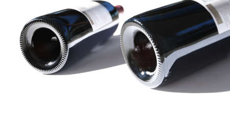 lavish: Exquisite Vineyard Quality Wine Bottles Lay Side By Side Ready For Tasting