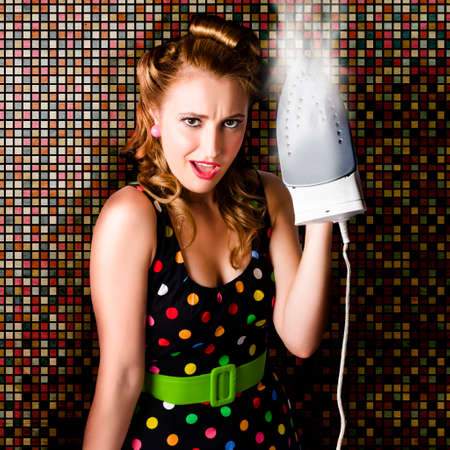 retro housewife: Beautiful Retro Housewife With Hot Style And Surprised Expression Steam Ironing Vintage Fashion Clothing