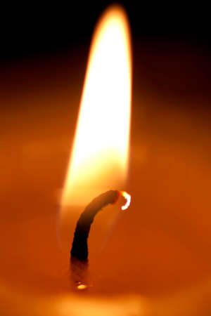 ignited: A Candle Flame Flickers In The Night Illuminating The Shadows Of Darkness