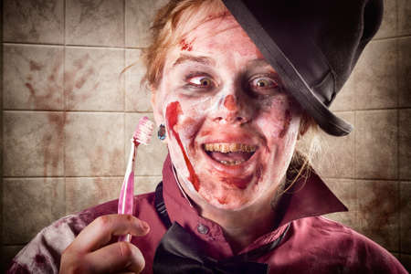 grisly: Funny female zombie smiling with yellow rotting teeth at dentist holding toothbrush. Tooth decay