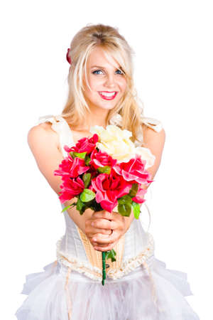 red flower: Beautiful young blond woman in dress with bouquet of red flowers, white background