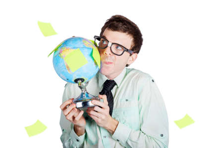 Isolated young businessman holding world globe while contemplating expansion into worldwide markets on white background Imagens