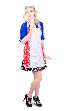 cake mixer: Full length picture of a pretty girl waiting for oven when baking cake, holding mixer spoon