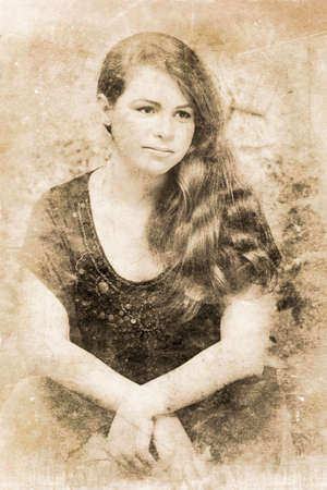 scuff: Scratched Faded And Textured Photograph Of A Vintage Lady From A Past Era Sitting Down Musing In Deep Thought, Image Contain Artifacts And Scuff Marks