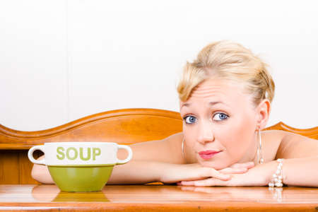 depiction: Retro waiter collecting money with soup bowl at restaurant counter in a depiction of tipping