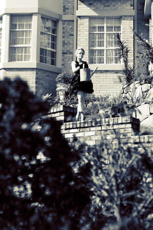hobbyist: Wealthy Female Gardener Hobbyist Working Her Mansions Front Garden During Her Free Time
