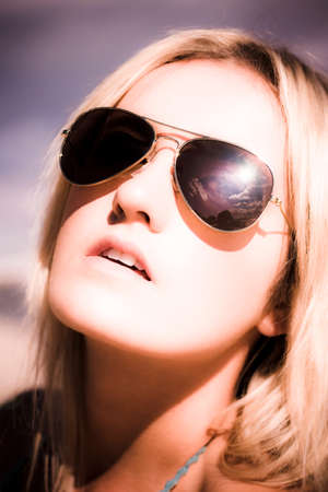 invigorate: Discolored Head Shot Or Face Portrait Of A Blond Beach Babe In Sunnies Or Sun Glasses In A Reflection Of Holiday Revitalization Refreshment And Rejuvenation