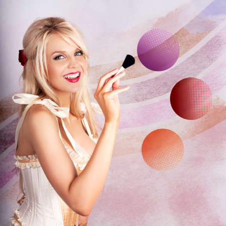 brush in: Creative Portrait Of A Beautiful Blond Makeup Woman Using Rouge Blush Brush In Colorful Make-up Pallet