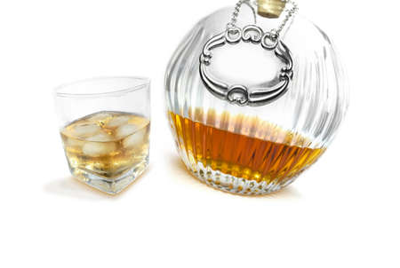 hard stuff: Bourbon Whisky Sits In A Alcohol Canter Next To Filled Glass, Ready To Be Consumed