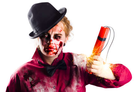 horrific: A woman in undead zombie makeup with a fistful of dynamite. Death and destruction Stock Photo
