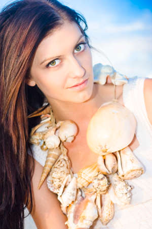 wellness environment: Wellness Woman Wearing A String Of Nature Around Neck In The Form Of Sea Shells While On A Natural Environment Vacation Escape