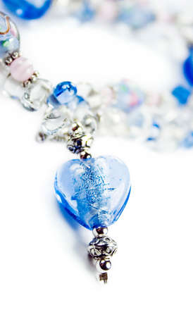 priced: Esquisite Blue Beaded Necklace Isolated On White Stock Photo
