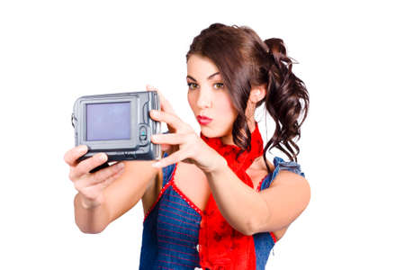 ravishing: Attractive young woman filming beauty, make-up and hair tutorial with video camera. Live recording
