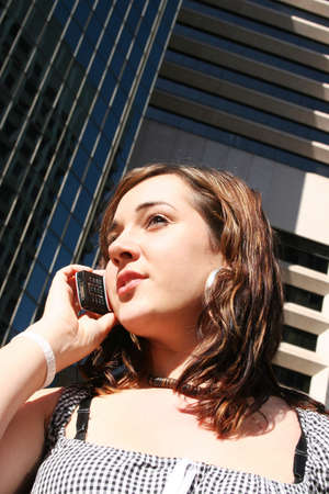 convinced: Corporate Lady Talks On Her Mobile Phone To A Potential Business Client