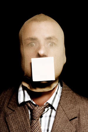 notelet: Wanted criminal with a crazed expression silenced with a crime stoppers sticky label on mouth with blank copyspace for your security advert or contact information Stock Photo