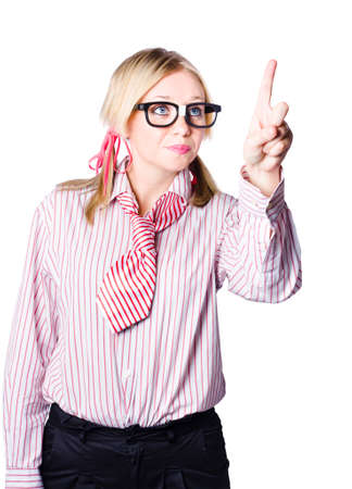 quirky: Half body portrait of quirky young blond businesswoman pressing invisible button with finger, white background.