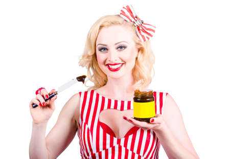 sandwich spread: Cute retro Australian pinup woman from 1950 holding yeast extract sandwich spread and jar. Australia icon Stock Photo
