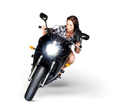 looking in corner: Studio Photograph Of A Good Looking Woman Riding A Motorbike Or Motorcycle Around A Corner With Headlights On In A Need For Speed Concept Isolated On White Stock Photo