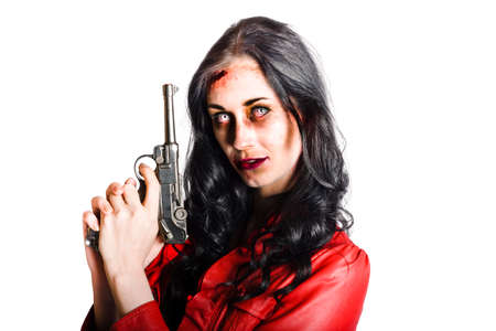 reanimated: Zombie looking woman in red leather jacket with staring eyes holding pistol in hand isolated on white background