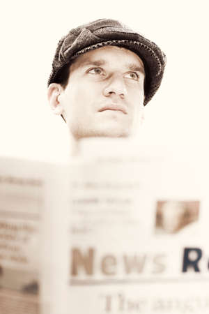 olden day: Olden Day Era Man Looks Up With A Worried Expression After Reading Bad News In The Vintage Times Stock Photo
