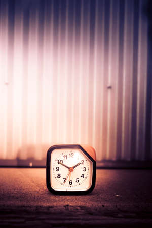 shadowy: Old Analog Clock On Cement. Shadowy Surroundings Stock Photo