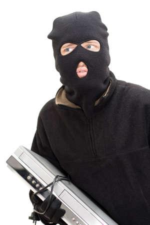 malandros: Un Disparo De Estudio Aislado De ladrones Tom mirando un poco aterrados mientras sostiene un DVD  Blue Ray jugador Foto de archivo