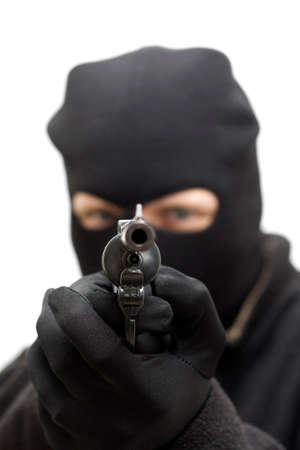 malandros: Un ladrón en postura amenazante, Apuntar un arma de la mano hacia el frente Foto de archivo