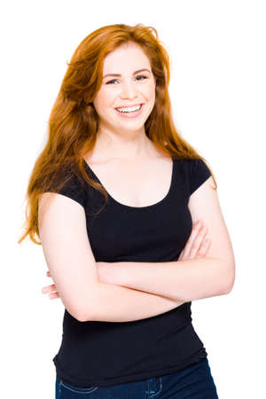 ebullient: Stunning Young Woman With Red Hair Smiling With Arms Folded Wearing Casual Black Shirt And Jeans In A Depiction Of Happiness, Isolated On White Stock Photo