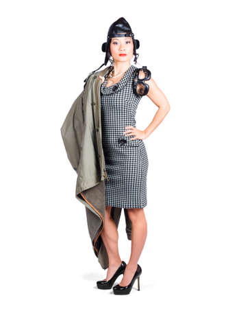 forbidding: Full body pin up portrait of a stern asian air force cadet wearing military issued leather flight cap goggles and jacket over white background Stock Photo