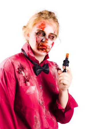 battered woman: Beaten and bloody woman holding a pistol or handgun. Gravely revenge