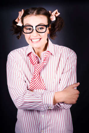 impish: Funny Female Business Nerd Smiling With Big Geeky Grin On Dark Studio Background