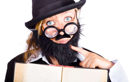disguised: Young woman disguised as male teacher with hat and beard holding open book, white background