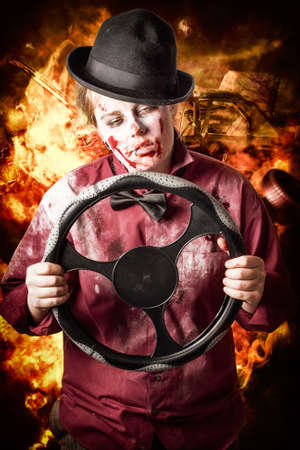 causing: Zombie holding car steering wheel causing an inferno of road chaos and traffic accidents when falling asleep at the wheel. Tired drivers die Stock Photo