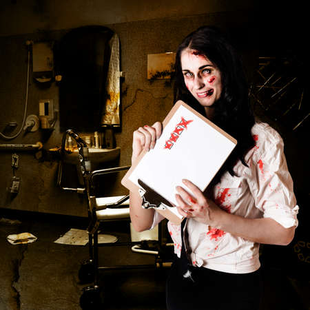 decrepit: Chilling zombie nurse standing in decrepit hospital with unhealthy checklist in a depiction of bad health Stock Photo