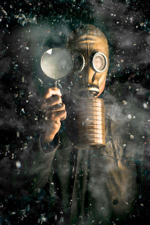pollutants: Scientist wearing a gas mask and holding a magnifying glass in a snow storm conducting research into the effects of gases, pollutants and carbon on climate change