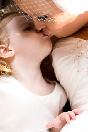 kissing lips: Family Love With A Bride Kissing Her Daughter In A Touching And Special Moving Marriage Moment