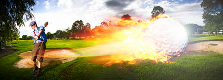 outside shooting: Sport Action Landscape Panoramic Of A Golf Player Hitting A Fast Paced Flaming Golf Ball Through The Golf Course Air In A Motion Of Flames And Fire