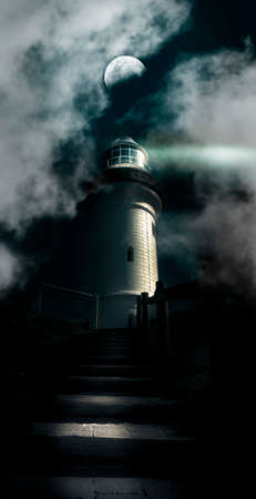 warns: Dark Atmospheric Lighthouse Shining A Beacon Off Into The Night Mist And Fog In A Storm Warning Of Dangerous Weather Conditions, Cape Byron Lighthouse Australia