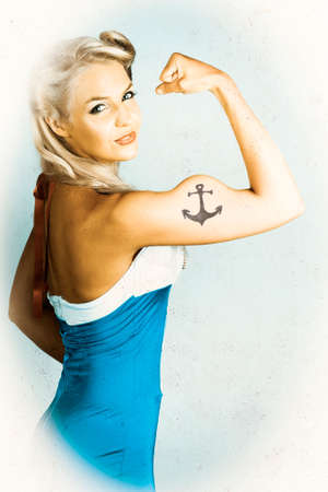 tough girl: Tough American Style Maritime Pin-Up Girl With Big Muscles And Anchor Tattoo