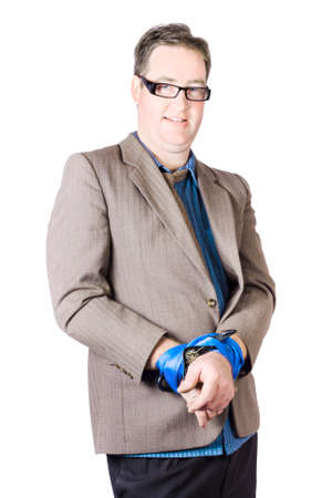 Portrait Of A Mature Businessman With Tied Hands On White Background Stock Photo