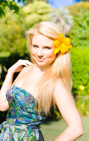 beauty girls: Provocative Tropical Beauty, a stylish blonde model with a yellow hibiscus in her hair poses provocatively.