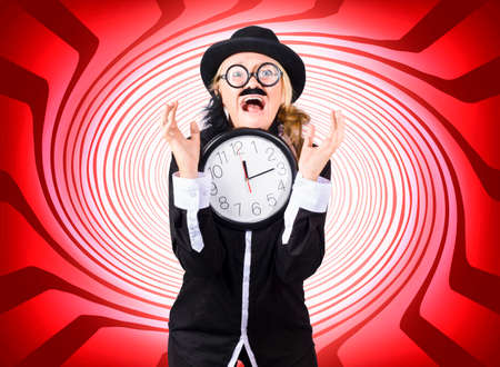 going crazy: Warped and crazy male scientist going insane while trying to solve the perplexities of the space time continuum by means of theoretical physics. Stock Photo