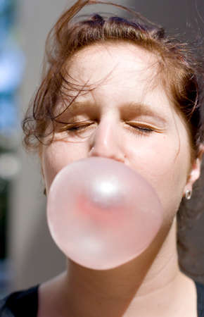 bubblegum: Lady Closes Her Eyes In Preparation Of A Imminent Pop While Blowing A Huge Gum Bubble