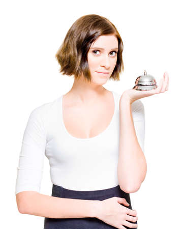 silver service: Female Business Woman Over White Holding A Silver Service Desk Bell In A Representation Of Good Old Fashioned Customer Service And Business Personal Relations