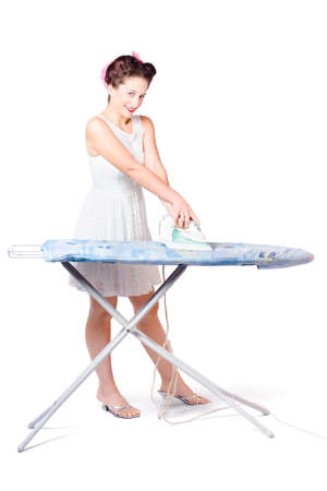 ironing board: Isolated full body photo of a cleaning lady steam pressing ironing board cover with  smile. Job done