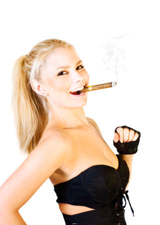 striding: Fun Success Concept. Humorous image of a jaunty young blonde woman with a ciger clamped between her teeth and wearing a sexy skimpy outfit striding out Stock Photo