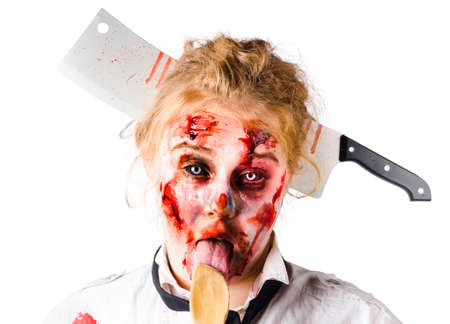 beaten woman: Beaten woman with meat cleaver in her head, licking a wooden spoon