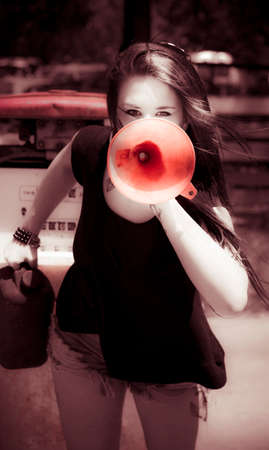 concerning: Sepia Image Of A Woman Protester Making A Environmental News Announcement On Issues And Problems Outside A Gas Service Station Using A Oil Funnel Speaker