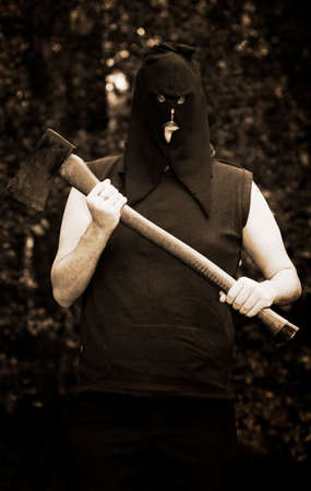 horrifying: Hooded Medieval Executioner With Axe Trees In Background