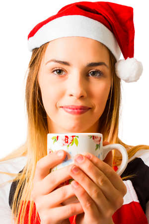 tiresome: Isolated photo of a tired girl waking to a cup of coffee while struggling with festive fatigue. Christmas break